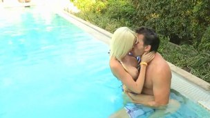 Shaved blonde with massive boobies fucked by the pool