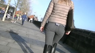 Candid mart stroller in constricted jeans and boots