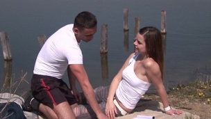 Relaxing by the lake this daring pair strips and fucks