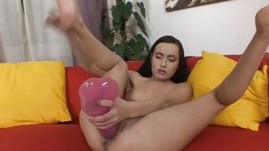 Rampant brunette toys her clammy pussy