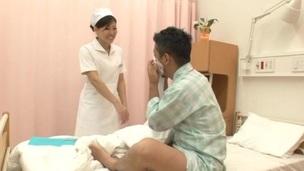 Japanese brunette nurse gives her patient awesome tugjob