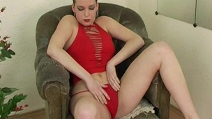 Randy babe in red blouse caressing her chest and toy fucking