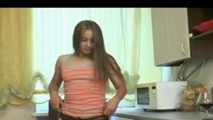 Shaggy girl in kitchen