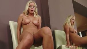 Blonde oriental Miela positions flirtatiously before masturbating